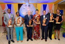 Back row L to R - Sir Tapley Seaton – Governor General of St. Kitts and Nevis, Celia Davidson Francis, Director of Alumni Relations for the UWI,  UWI Chancellor Robert Bermudez. Sir Rodney Williams – Governor General of Antigua and Barbuda, Jacqueline Sharp-  UWIAA President Jamaica Chapter, UWI Vice Chancellor Sir Hilary Beckles.     Front Row L - R - Awardees  - Dr Andre Haughton, Professor Merle Collins, D. Karl Massiah, Ambassador Dr June Soomer, Justice Dr Irving Andre, Dr Lloyd Stanford, Dr Nicole Nat
