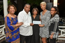 ( L- R) Cecille Grant and Donat Grant with  Carmen Nicholas - Florida Chapter President, Celia Davidson Francis - Director of Alumni Relations for the regional UWI  and Miriam White, Florida Chapter Executive member