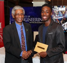 Mr. Jachin Mullings receives the Class of 1967 Award from Professor Neville Ying.