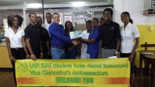 Figure 1- Seen in the picture above is the handing over of the nebulizer by Mr. Brown on behalf of the Jamaica Hospital Supplies from left to right Shamonique(D), Marlon(A), Kristoff(A), Oshane(D), David Brown(J), Donna-Marie Madourie(J), Nurse(H), Matron(H), Melanie Walker(H), Deryck(A) and Nattallee(D) A-AmbassadorD-DesignateH-Representative HospitalJ- Representative of Jamaica Hospital Supplies