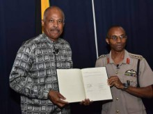 UWI Vice Chancellor, Professor Sir Hilary Beckles and Chief of Defence Staff Lieutenant General Rocky Meade (right) with the Memorandum of Understanding. (Photo: Norman Thomas)