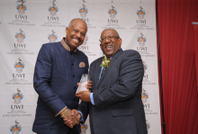 Caption: L to R: Vice-Chancellor Professor Sir Hilary Beckles receives his long service award from Pro Vice-Chancellor and Campus Principal of The UWI Mona, Professor Dale Webber.